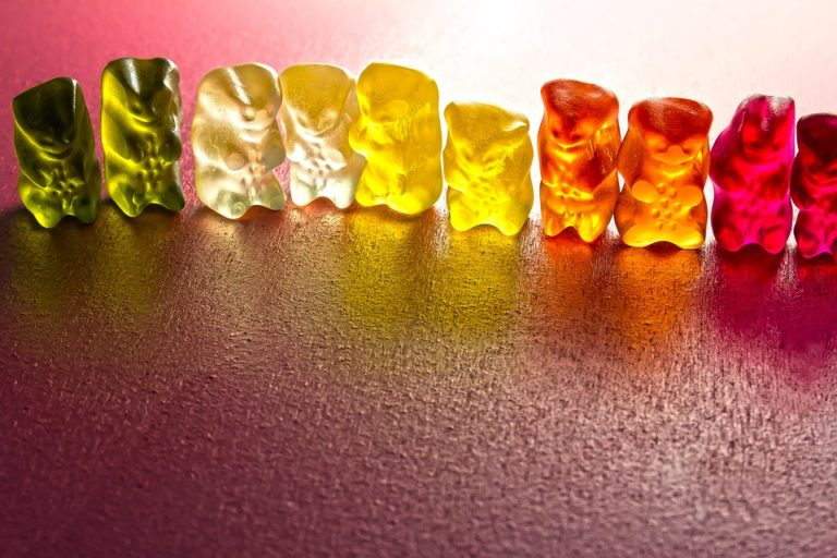 Different colour jelly beans in a line